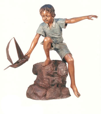 Boy Playing with Toy Boat Sculpture