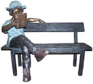 Boy with Hat on Bench Reading