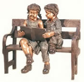 Bronze Boy and Girl on Bench Reading