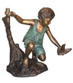 Boy with Toy Boat Sculpture