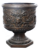 Bronze Cherub with Flowers Urn