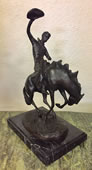 Rodeo Cowboy on Horse Bronze Statue
