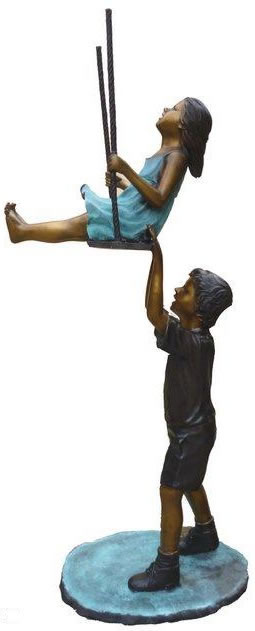 Boy and Girl Swinging Sculpture