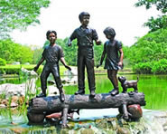 Kids on Log- Bronze Sculpture