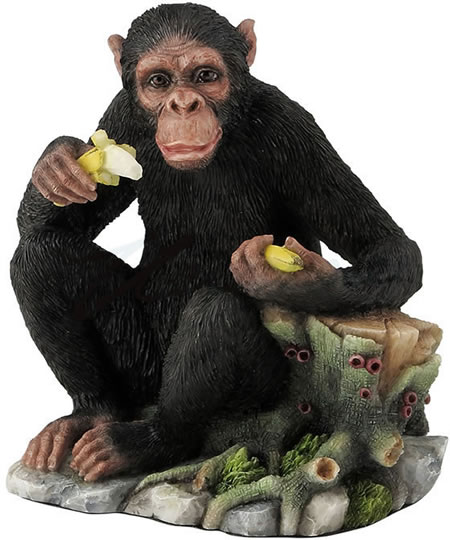 Chimpanzee Eating Bananas by Tree Stump Statue