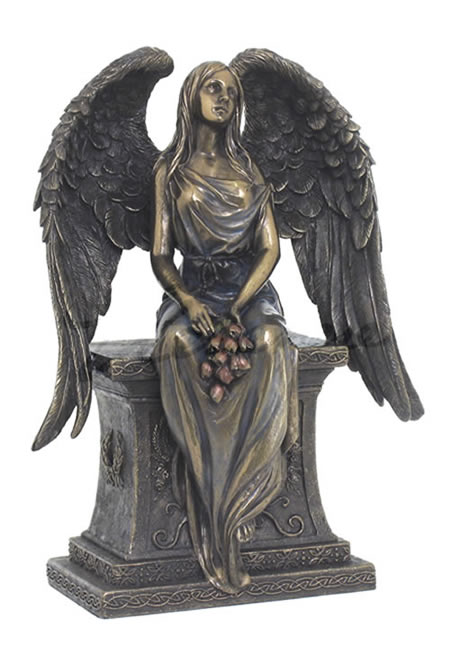 Angel With Roses Sitting On Tombstone Statue