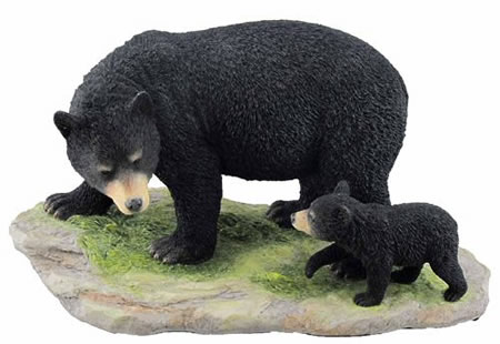Black Bear Cub Following Mother Statue