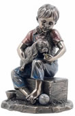 Boy with Puppy Dog Sculpture