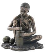 African Woman Grinding Grain Statue
