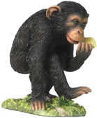Munching- Baby Chimp Figurine