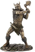 Viking Warrior Swinging An Axe Statue